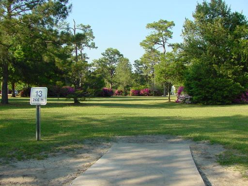 Tee box view of Hole #13 (#4) at Park Circle Disc Golf Course.