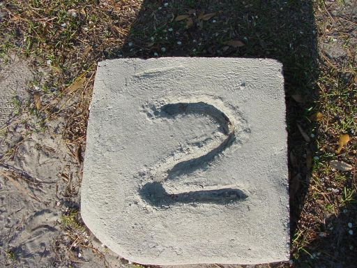 Tee marker from Hole #2 (#11) at Park Circle Disc Golf Course.