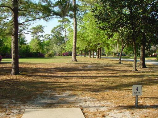 Tee box view of Hole #4 (#13) at Park Circle Disc Golf Course.